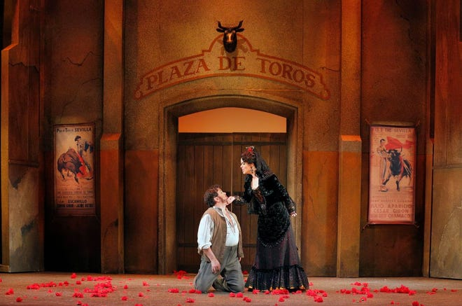 """Rafael Davila as Don José and Zanda Svede as Carmen confront each other outside the bullring in Act IV of Georges Bizet's """"Carmen"""" during a 2016 Lyric Opera of Kansas City performance. The opera will open Palm Beach Opera's season Jan. 28."""