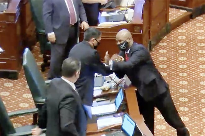 "House Speaker Emanuel ""Chris"" Welch (right) congratulates Rep. Anthony DeLuca, D-Chicago Heights, following the passage of House Bill 642 on the house floor Thursday. The bill would prevent any member of the House or Senate from serving more than 10 years in a leadership position in either chamber."