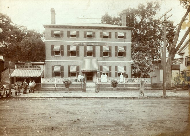 """The Hotel Merrick, previously the Treadwell-Jenness House, on Pleasant Street in Portsmouth. The hotel was in operation from 1901 until it was sold to the Elks Lodge in 1908. To the left is the Chicago Meat Company, owned by Christopher Smart. A sign on the Court Street side to the right reads """"Bowling Alley."""""""