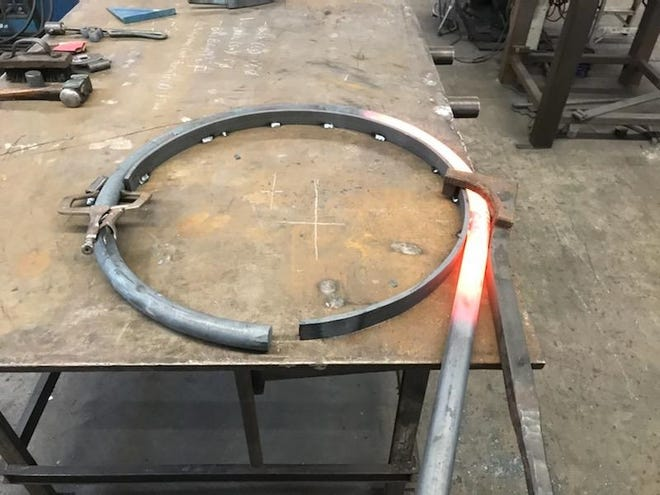 Metal in the process of being forged by blacksmith, Andrew Molinaro, owner of Artisans of the Anvil in Stroudsburg. The component would eventually become part of a new bike rack in the borough.
