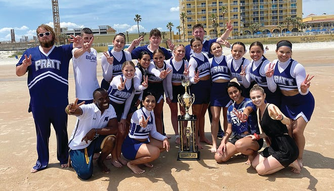 The Pratt Community College cheer squad shows their excitement after a traditional victory dive into the ocean at Daytona Beach, Florida during the 2021 Natnational cheer competition.