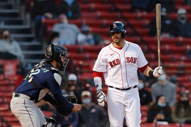 Boston's J.D. Martinez, right, reacts beside Seattle catcher Luis Torrens after striking out during the first inning Thursday night.