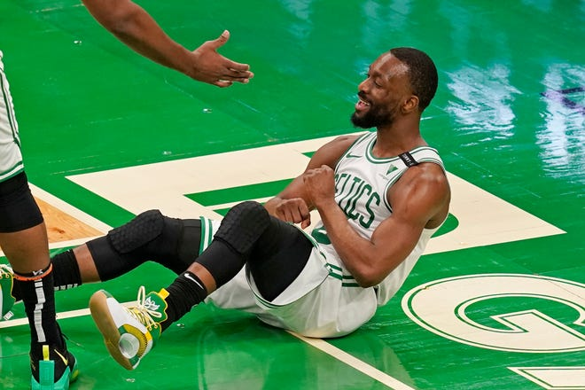 Boston Celtics guard Kemba Walker celebrates after drawing a charging foul in the second half of an NBA basketball game against the Phoenix Suns, Thursday, April 22, 2021, in Boston. (AP Photo/Elise Amendola) ORG XMIT: otkea105