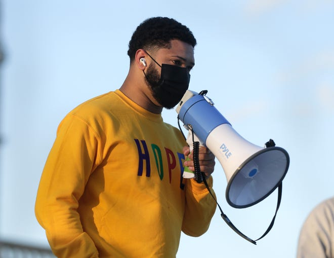 Harrison Tuttle, executive director of Black Lives Matter RI PAC, addresses a small group at the State House on Thursday evening protesting the police killing of 16-year-old Ma'Khia Bryant on Tuesday in Columbus, Ohio.