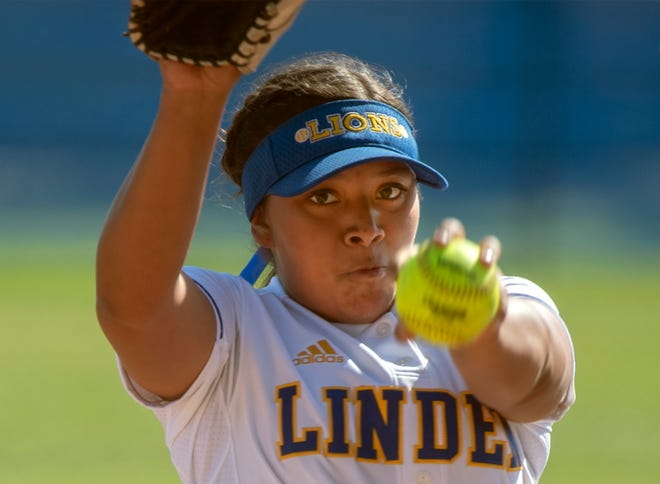 Linden's Hannah Ortega winds up to deliver a pitch during a varsity softball game against Stagg in Linden. CLIFFORD OTO/THE STOCKTON RECORD