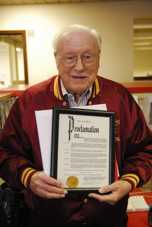 """Persh Rohrer is pictured on his 90th birthday in 2008 holding a proclamation from then-Ravenna Mayor Kevin Poland declaring Nov. 11 """"Persh Rohrer Day."""""""