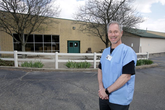 Stark County Coroner Ron Rusnack stands in front of the Lester Higgins Adult Workshop building, which will become the new coroner's office.