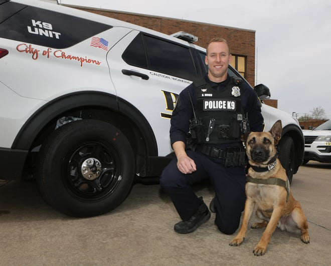 Massillon police officer Ryan Wood is pictured with his new K-9 partner, Loki, outside of the Police Department building. Wood and Loki began regular patrols together earlier this week.