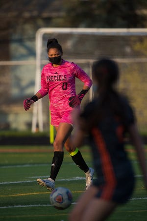 Freeport goalie Naomi Jackson clears the ball against Auburn during their NIC-10 game on Thursday, April 22, 2021, in Freeport. The Pretzels beat Auburn 8-0, and now will take on Belvidere North at home on Friday, June 4, 2021, in the regional final.