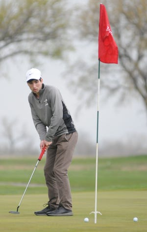 Salina Central's Nolan Foley watches his par putt on the first green during the Salina South Invitational on Friday at Salina Municipal Golf Course. Foley finished fifth with a round of 78 and the Mustangs shot 329 as a team to take third.