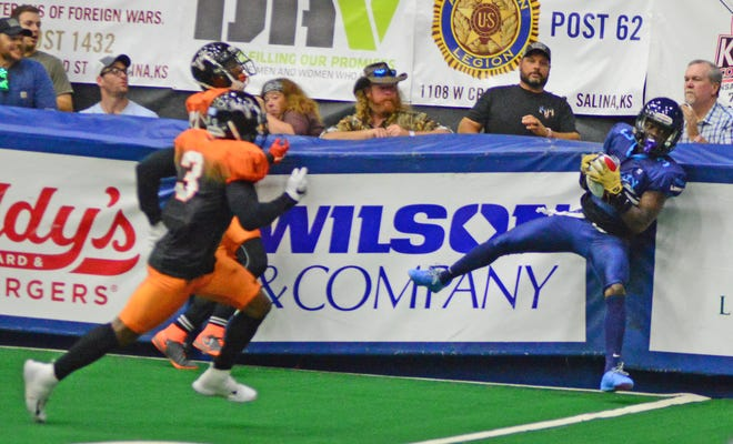 Salina Liberty wide receiver Ed Smith (3) catches a pass near the wall during the game against Omaha Beef in 2019.