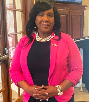 LaShawnda Pinkney stands in the Murabella amenities center in St. Johns County during a meet-and-greet event Friday, April 23. Pinkney, a Republican from West Augustine, has filed to run for St. Johns County Commission District 2, a seat currently held by Commissioner Jeb Smith, a farmer from Hastings.