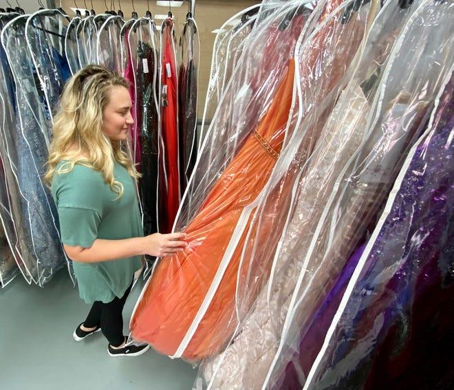 Heidi Coggins browses dresses for prom.