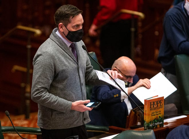 State Rep. Tim Butler, R-Springfield, asks for clarification on what data set will be used for the redrawing of legislative maps during session on the floor of the Illinois House at the state Capitol on Friday.
