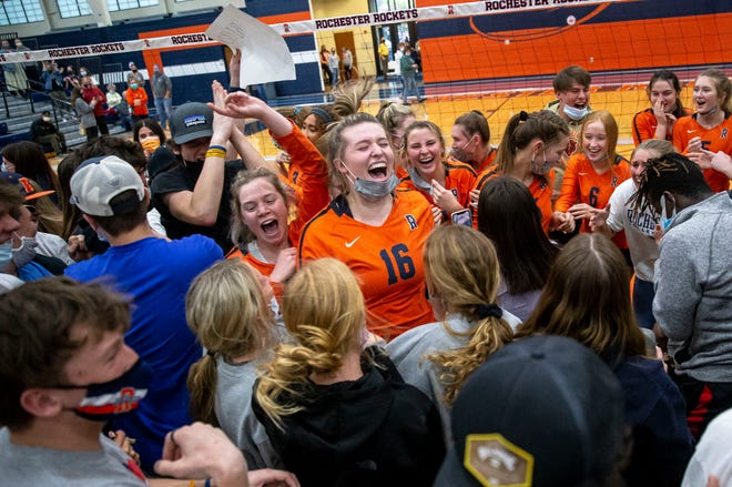 Rochester's Lauren Bloom (16) celebrates with the student section as they rush the court to celebrate the Rockets defeating Normal U-High in the championship game of the CS8 Volleyball Tournament at the Rochester Athletic Complex in Rochester, Ill., Thursday, April 22, 2021. [Justin L. Fowler/The State Journal-Register]
