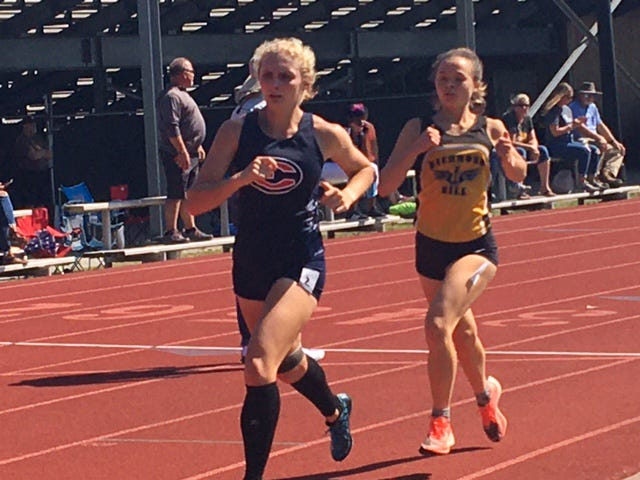 Effingham County's Candace Kieffer holds the early lead against Richmond Hill's Reese Wilson during the first lap of the 3,200 run at the Region 2-6A track and field meet on April 21. Kieffer won the region title in the 1,600 and placed second in the 3,200.