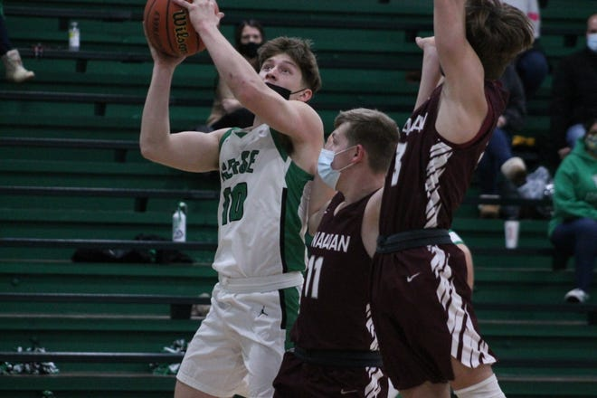 Coltin Quagliano (10) drives for a score under double coverage in a boys basketball game on Feb. 12. Quagliano was named to the Associated Press Class 1A all-state team for a third straight time.