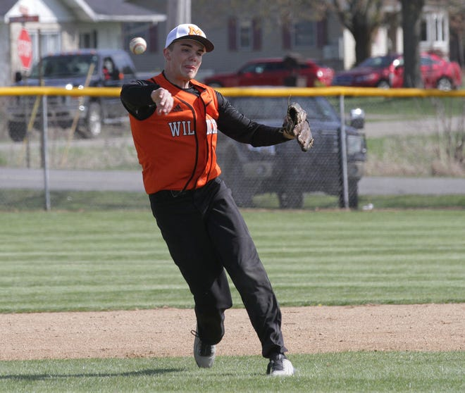 Gavin Etter of Marcellus tosses over to first base to get an out against Colon on Friday.