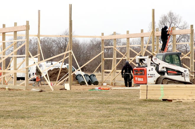 In March, workers put up the wooden framework for a storage facility on Kitson Avenue. The price of lumber continues to climb, as demand outweighs current supply.