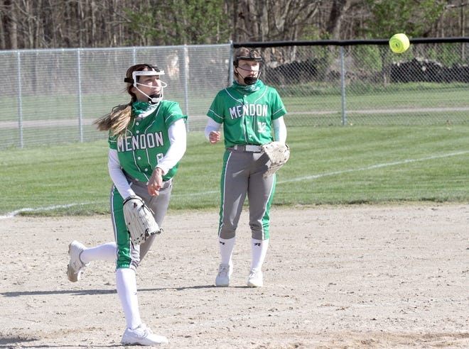 Mendon pitcher Lauren Schabes first over to first base to record an out after fielding a ground ball against White Pigeon on Thursday.