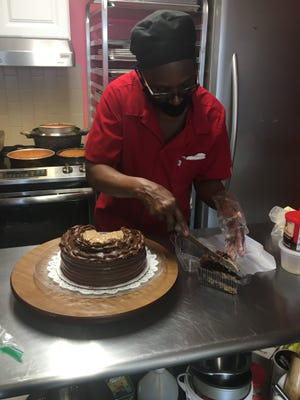 Owner Jean Smith cuts a German Chocolate cake at Sweet Momma's Bakery in Norwich. The Bakery is one of 46 businesses participating in the Greater Norwich Area Chamber of Commerce's  Restaurant Week.
