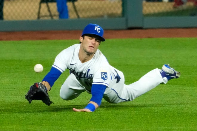 Kansas City Royals left fielder Andrew Benintendi is unable to make the catch April 12 against the Los Angeles Angels during the ninth inning at Kauffman Stadium in Kansas City, Mo.