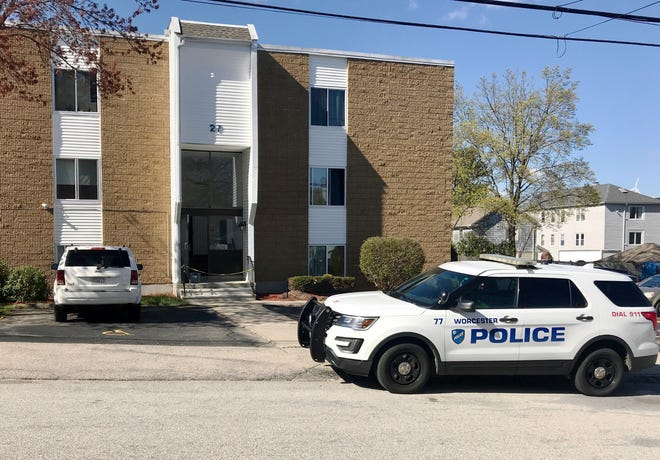 Police at 27 Halmstad St., the scene of a fatal stabbing Friday.