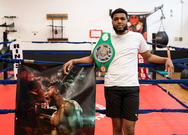 Worcester's Kendrick Ball Jr. shows off his WBC USNBC Silver super middleweight championship belt last week at Camp Get Right Boxing Gym.