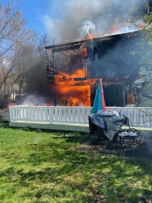 Worcester firefighters encountered heavy flames pouring from a duplex on Joseph Street, where explosions were also reported in the Friday morning fire.