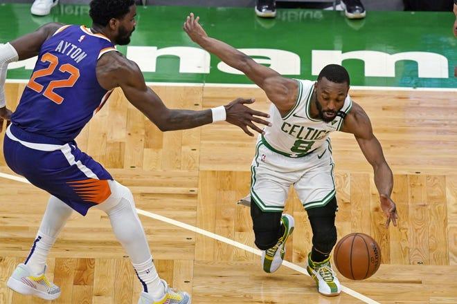 Celtics guard Kemba Walker drives against Phoenix Suns center Deandre Ayton on Thursday night at TD Garden.
