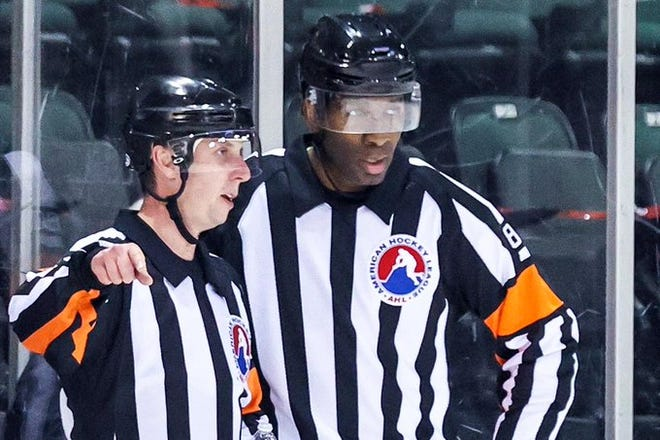 Former Worcester Railer Jordan Samuels-Thomas, right, is now a referee in the American Hockey League.