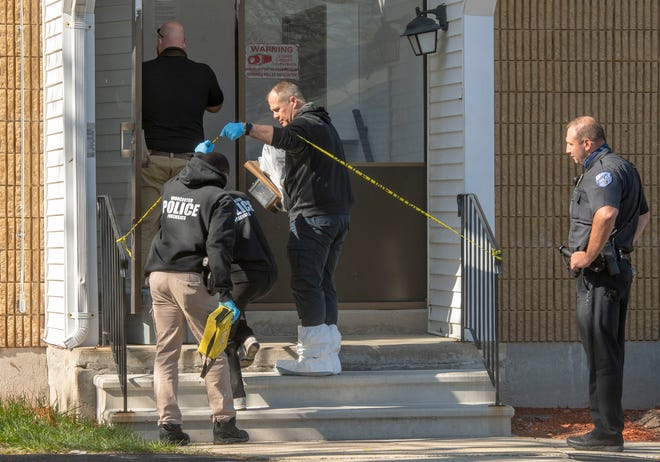 Worcester Police crime scene investigators enter an apartment building at 27 Halmstad Street