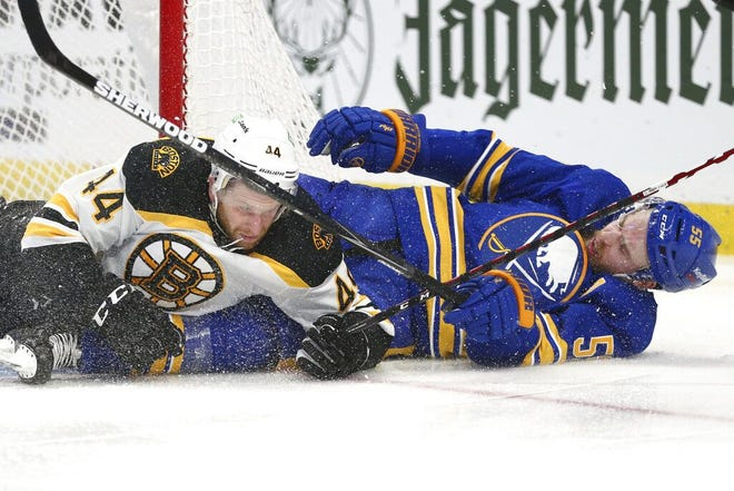 Bruins defenseman Steven Kampfer, left, and Buffalo Sabres defenseman Rasmus Ristolainen crash to the ice during the second period Thursday night in Buffalo, N.Y.
