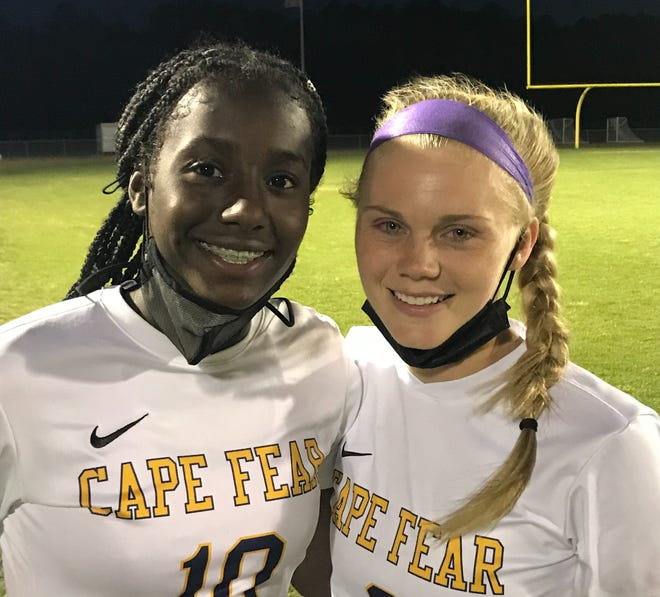 Freshman star Jayda Angel, left, and junior Dylan Sneed netted goals in the match at Gray's Creek that delivered the Colts a title.
