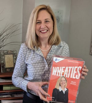Alachua County Public Schools Food and Nutrition Services Director Maria Eunice named 'Trayblazer' by General Mills for going above and beyond to feed children during COVID-19. Eunice received a commemorative Wheaties box replica featuring her name and photo.