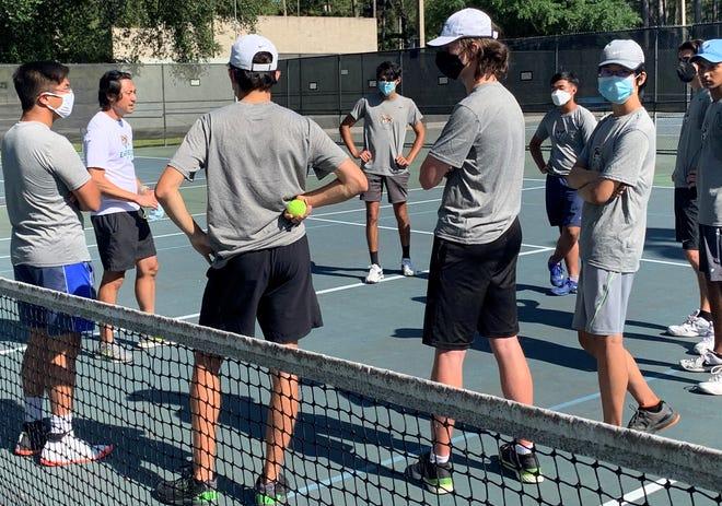 The Eastside High boys tennis team discuss state tournament plans.