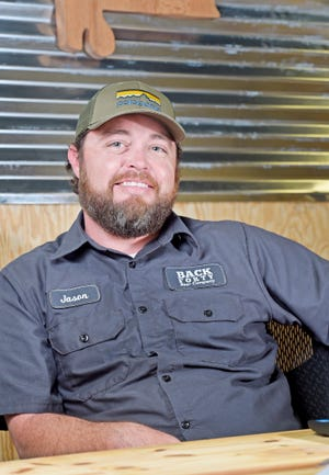Jason Wilson, shown in a file photo at Back Forty Beer Co., is leaving the company he founded in 2009, although he'll remain on the board of directors.