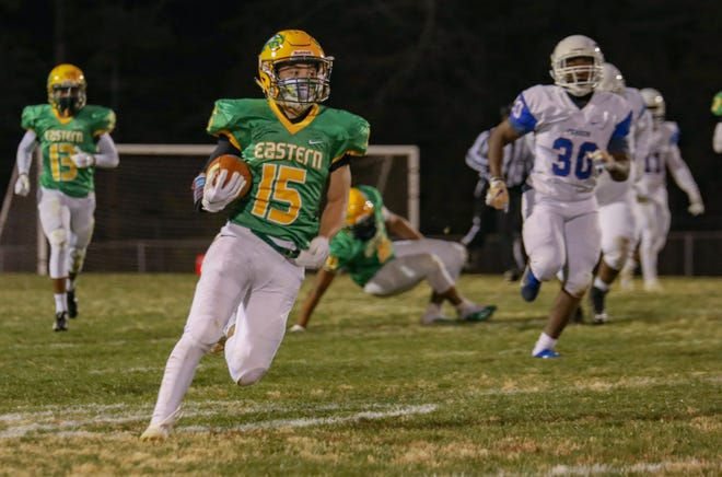 Eastern Alamance receiver Hunter Westbrooks carries the ball in a game against Roxboro Person.