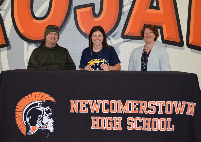 Signing a letter of intent is to play softball at Kent State Tuscarawas is Arianna Stull, seated between her father Rich (left) and her mother Dana.