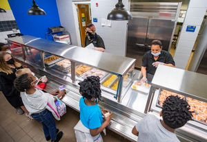 Students at Cedar Grove Elementary School line up for chicken and waffles on the school lunch menu Thursday, April 22, 2021.