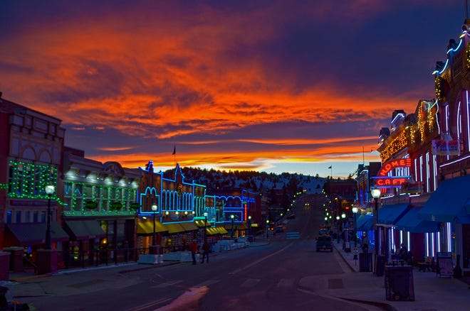 The lights and the sunset provide for a spectacular show on Cripple Creek's main drag, Bennett Avenue