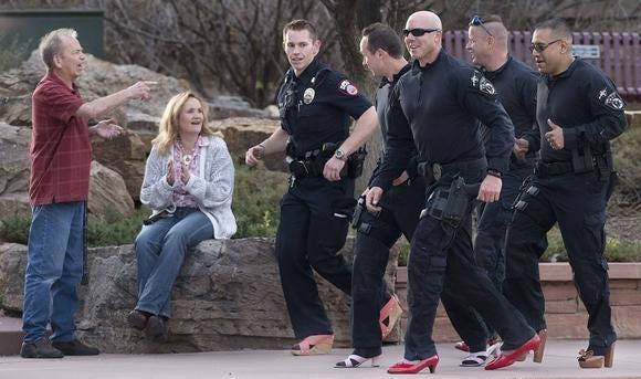 Pueblo police officers participate in Pueblo Rape Crisis Services' Walk a Mile event at the Historic Arkansas Riverwalk in 2018
