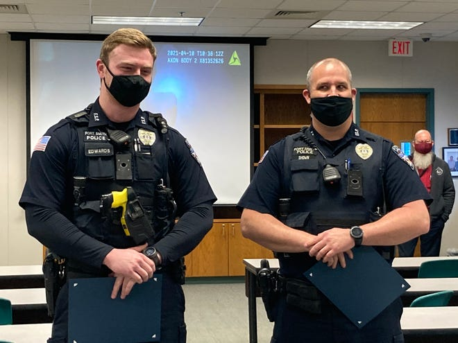 Fort Smith Police Department Officers Colby Edwards, left, and Clinton Shown accepted a commendation from the Fort Smith Police Chief Danny Baker Friday, April 23, 2021.