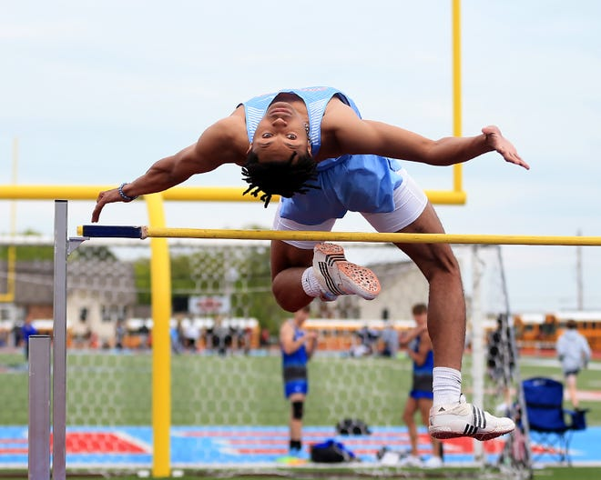 """Southside's Jonah Hill clears the bar set at 6'2"""" before winning with a jump of 6'4"""", Thursday, April 22, in the McDonald's Relays at Southside."""