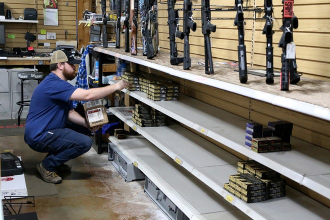 Bobby Hill works behind the counter at Gellco Outdoors, 4600 S Zero St., stocking what ammo they have available for sale, Friday, April 23, in Fort Smith.