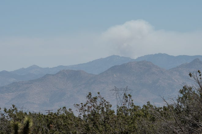 A column of smoke rises above the San Bernardino Mountains on Friday, April 23, 2021.