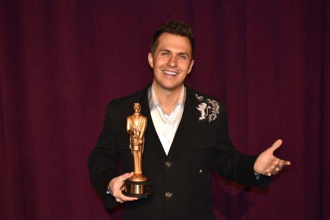 Brett Myers, a Chambersburg native, is awarded his Merlin Award by the International Magician's Society
