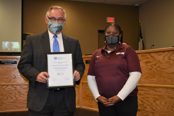 Dr. Bill Johnston, ROISD Asst. Superintendent Business Services/Chief Financial Officer, was presented the certificate.