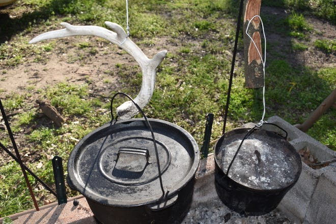 Luke's outdoor cooking set up. Just about anything that can be cooked inside in the kitchen can be prepared over coals in a Dutch Kettle.