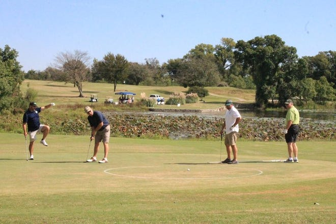 Golfers compete in a benefit tournament at Waxahachie Country Club in 2016.